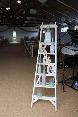 old painted ladder display at rustic country wedding