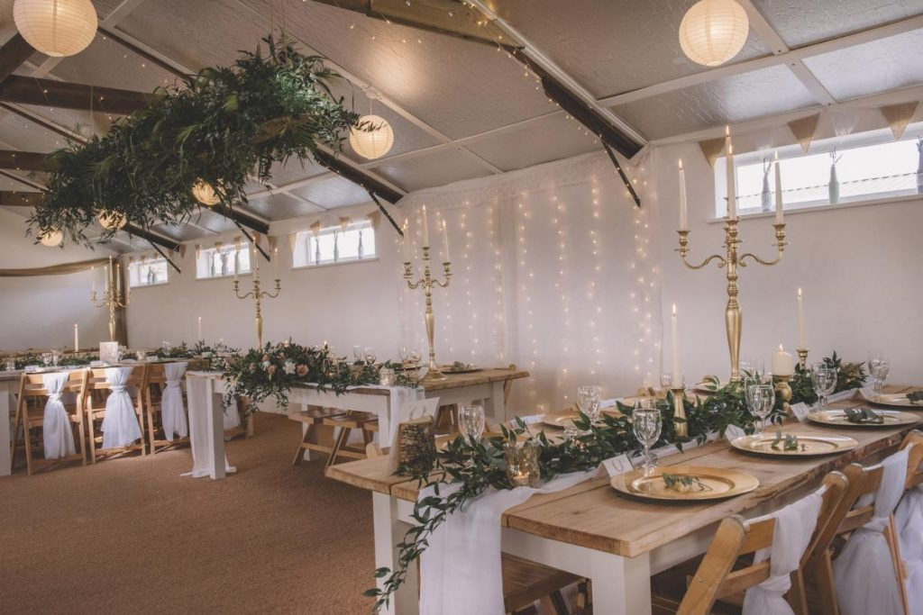 Barn wedding venue with greenery