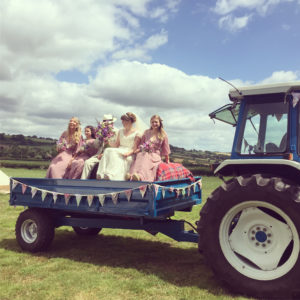 Bride Amy arriving by tractor