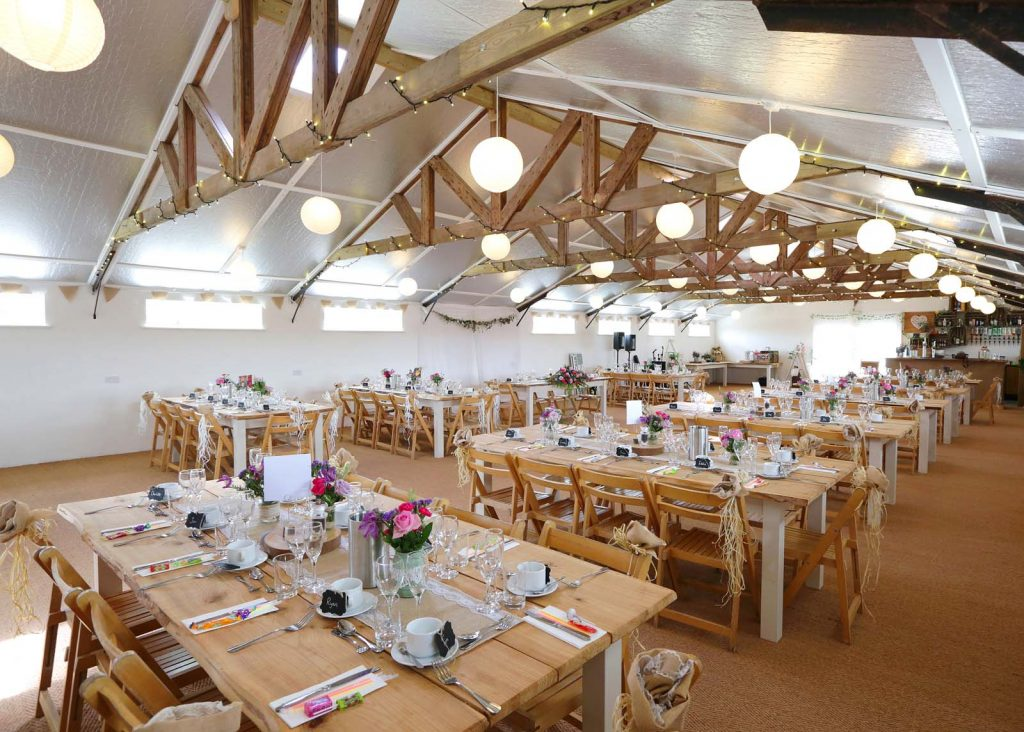 Wedding venue with handmade tables & wooden chairs in Somerset
