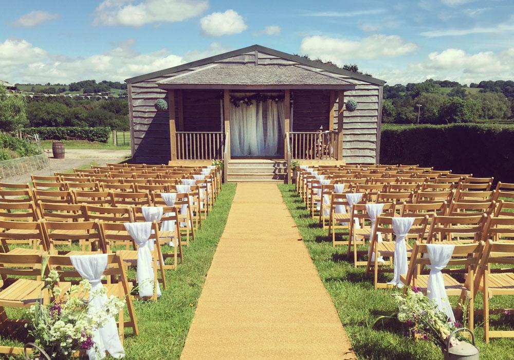 Outdoor ceremony at The Barn at Cott Farm wedding venue